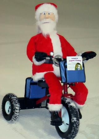 robots by Santa on trike by Animated Magical Moments in Northamptonshire