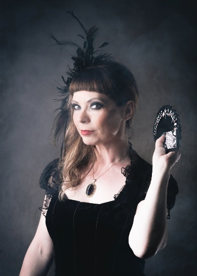 Careena Fenton as Female Magician Sylvia Sceptre