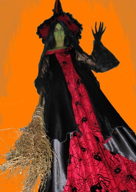 Esmeralda Witch on Stilts Red Witch based in South Yorkshire