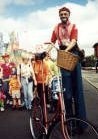 Bo the Clown as Bo Chanson French onion seller on stilts bike