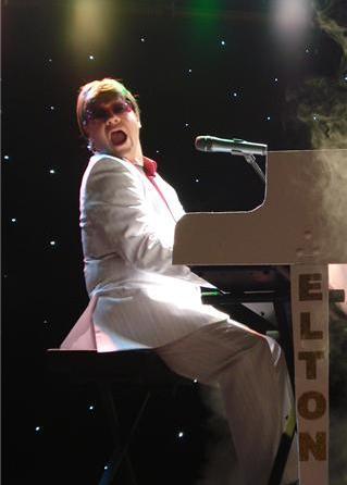 Joel Coombes as Elton John Impersonator, Look alike and Tribute Artiste based in North East England and available through A.R.C. Entertainments