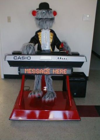 Hairy Monster playing keyboards