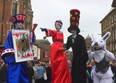 Knave of Hearts, Queen of Hearts, Mad Hatter Stilt walkers from Alice in Wonderland by Neighbourhood Watch Stilt walking international of Tyne & Wear