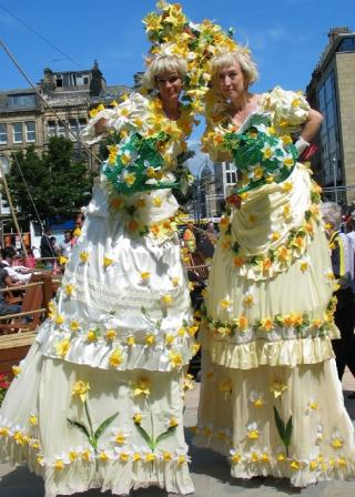 Daffodil Flower Ladies on stilts by Rachel H