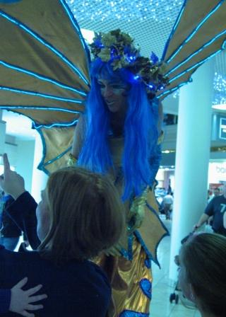 Zaffiella the fire fly on stilts is a light up costume on stilts based in South Yorkshire and available through A.R.C. Entertainments