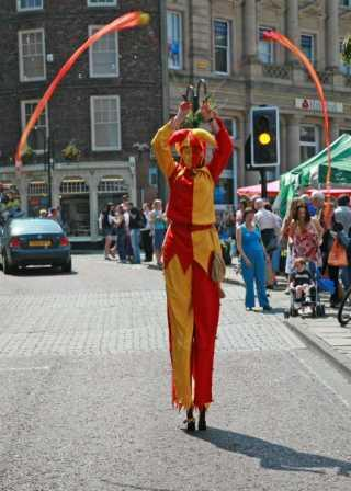 stiltwalking jester with or with poi or balloon modelling by Sarah Shearer