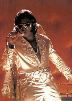 Shenton Dixon as Elvis Presley