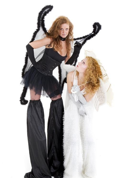Black & White Angels on stilts by The Dream