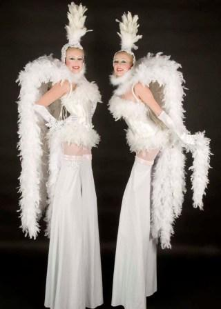Snow Girls on stilts by The Dream Tink