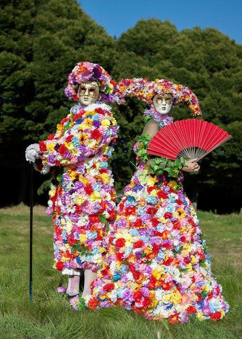 The Blooms / Flower stilt walker (masked) by The Dream